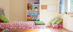 Bright yellow room with pink decorations for girl