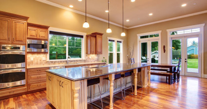 29735310 - spacious kitchen inteiror with kitchen island and dining area in luxury house